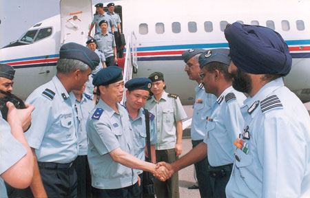 PLA officers shake hands with their IAF counterparts at Jodhpur AFS. Cannot Be Enlarged